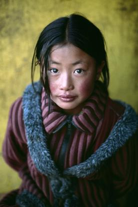 Steve Mucurry, TIBET. Xigaze. 2001. Girl in New Coat.