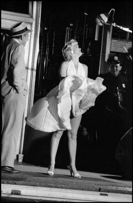 "Elliott Erwitt, Marilyn Monroe during the filming of ""The Seven Year Itch"". Director Billy Wilder is in the background . New York, USA. 1954"